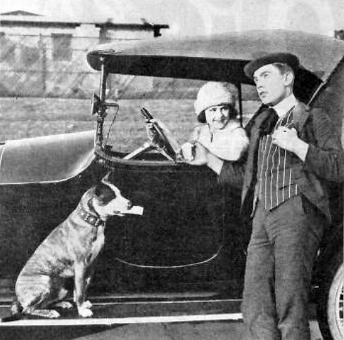 Harry Sweet with Brownie the Wonder Dog and actress Louise Lorraine while working for Century Films.