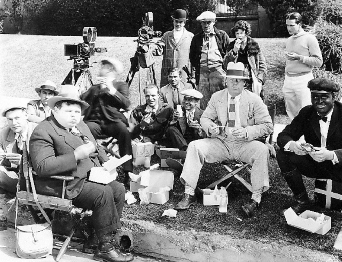 Harry, center wearing a white hat, on location with actor Charles Puffy, left foreground.