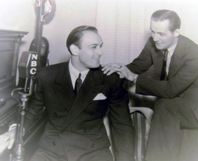 Fidler, right, and actor/singer Russ Columbo in the NBC radio studio, Los Angeles, 1934.